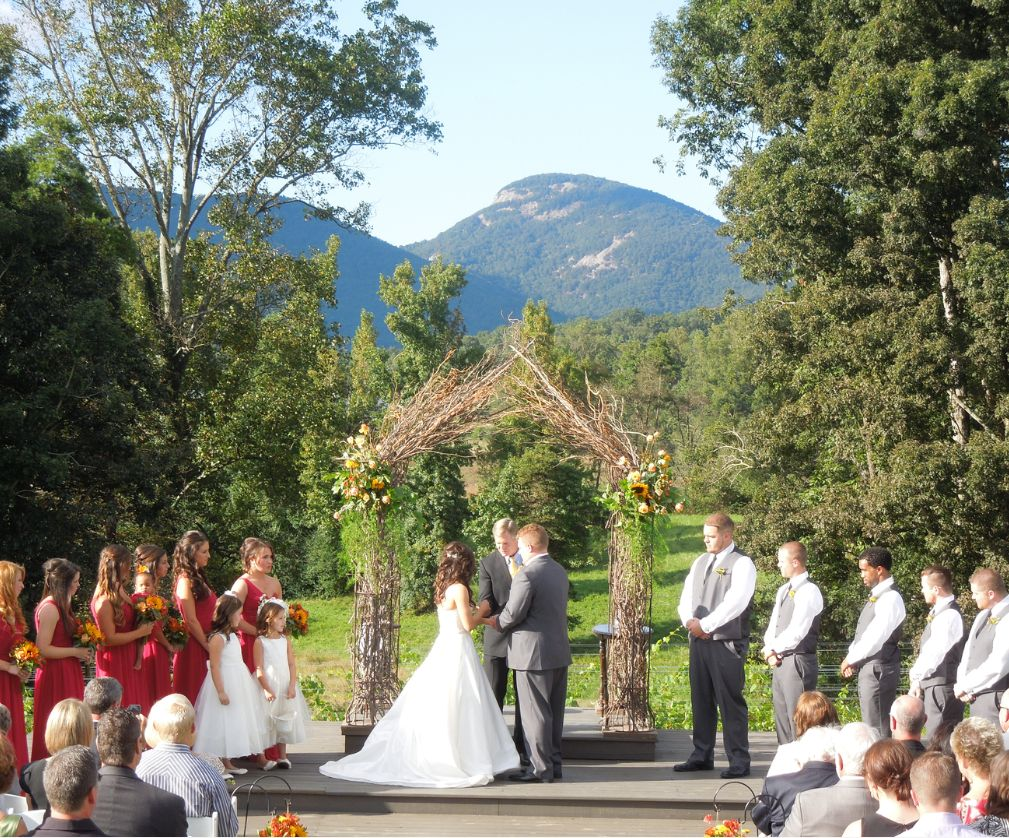 A wedding ceremony at Cenita with Yonah Mountain towering in the background.
