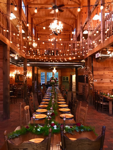 The elegant reception barn space at Sanctuary, lit and decorated.