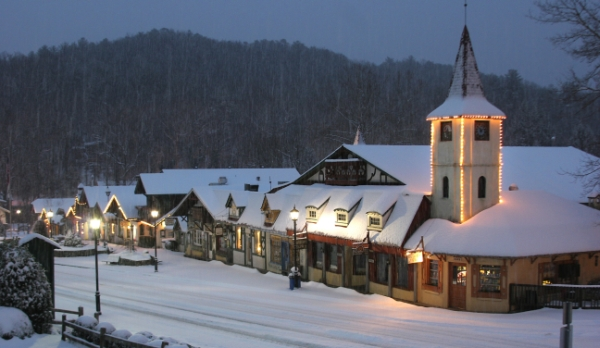 The twinkling lights of the lovely snow covered village of Alpine Helen, Ga at dusk.