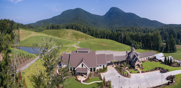 Bird`s eye view of Yonah Mountain Vineyard with dramatic mountains in the background.
